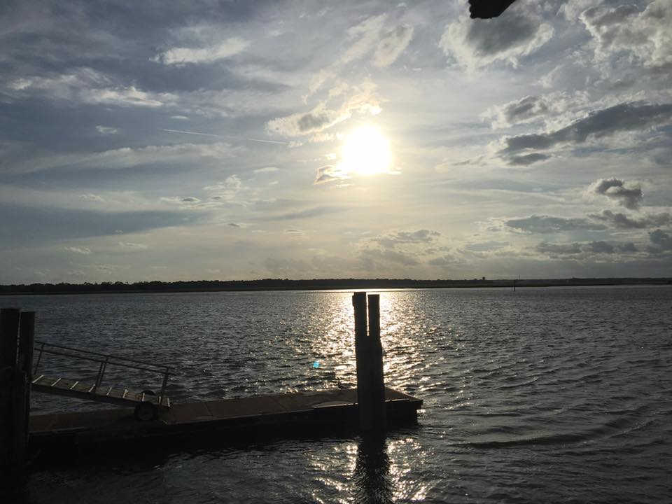 sunset on the river with dock