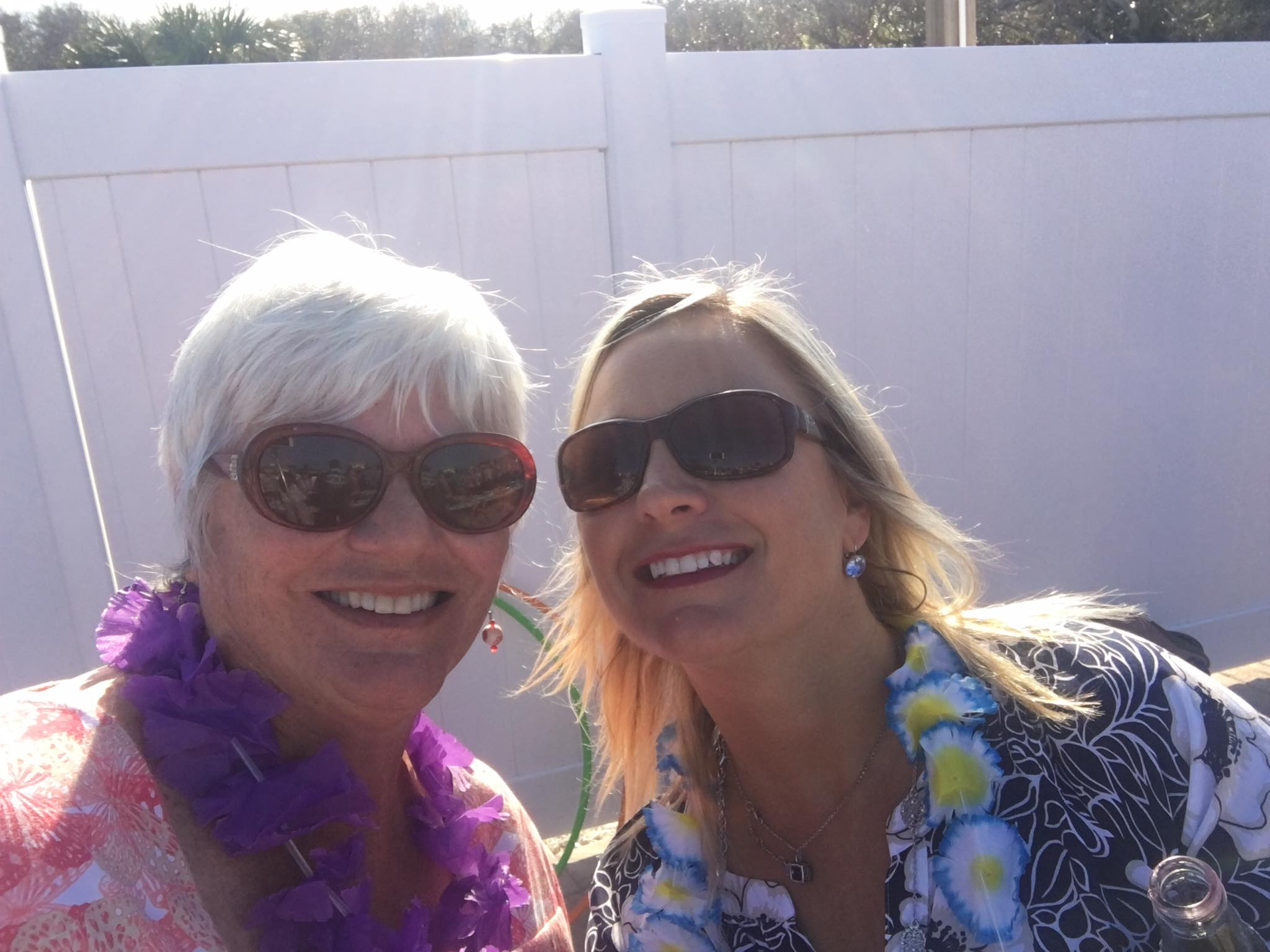 two women wearing leis
