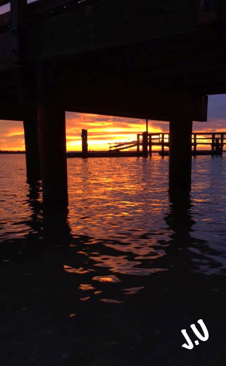 sunset below the pier