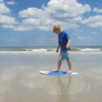 boy on paddleboard