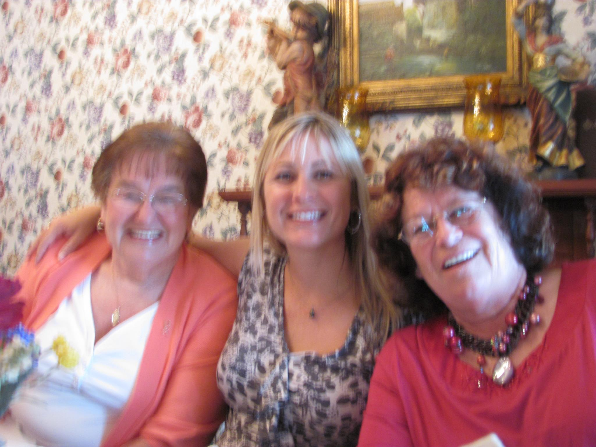 three woman smiling for camera