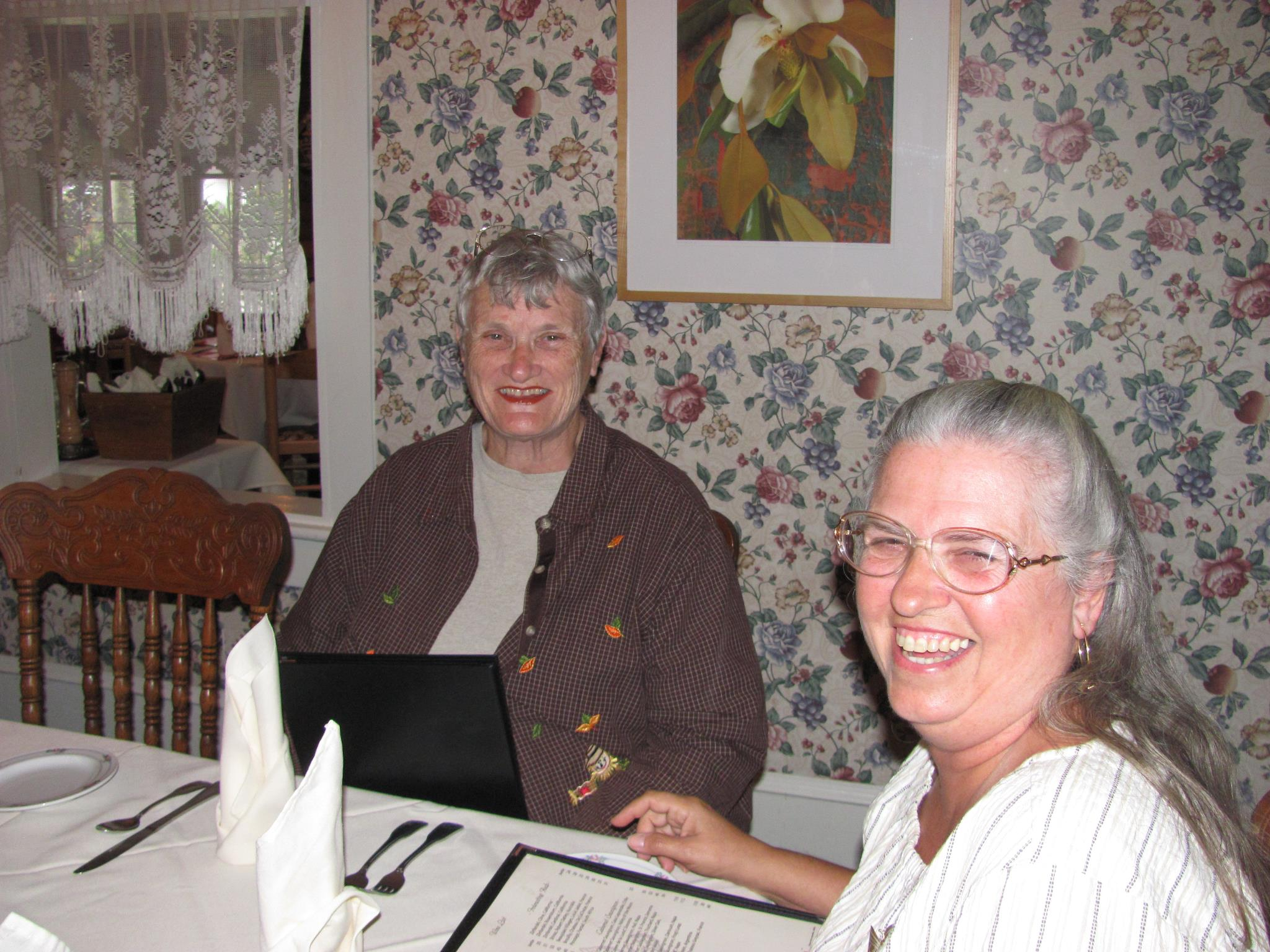 two women looking at menu and smiling