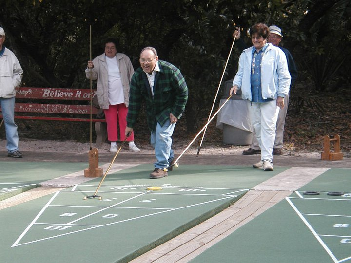 people playing shuffleboard