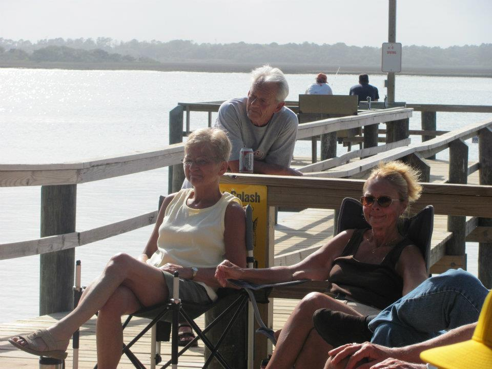 people sitting on the dock