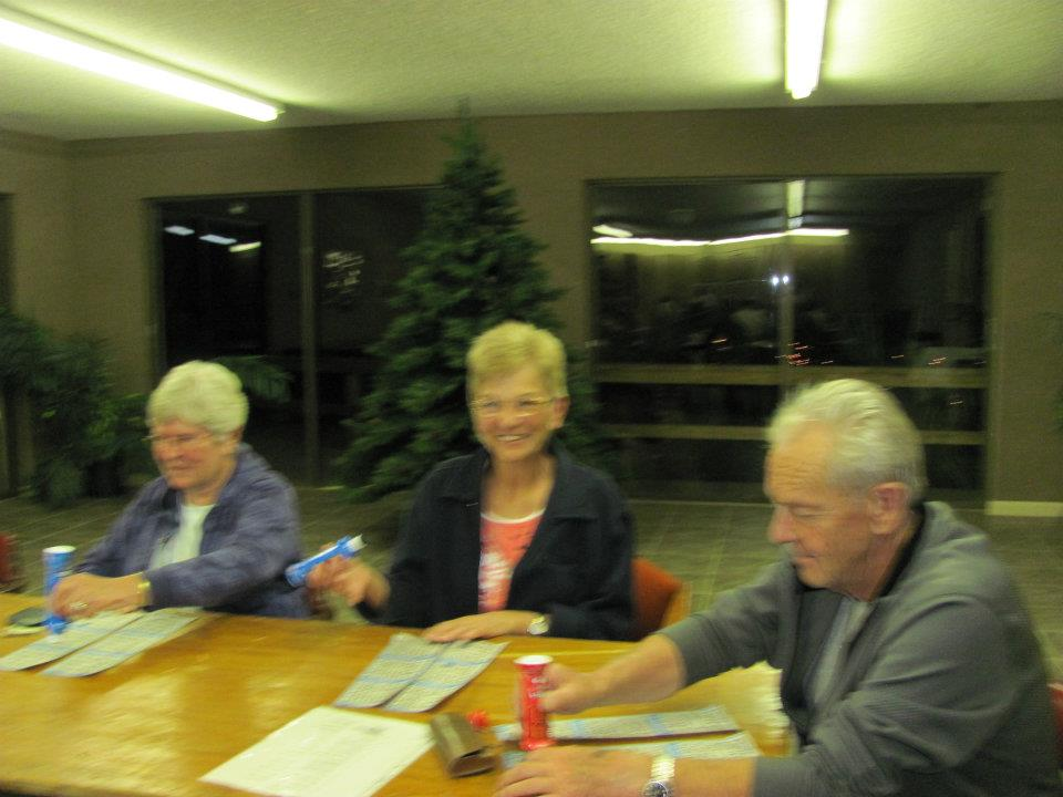 three people sitting at a table