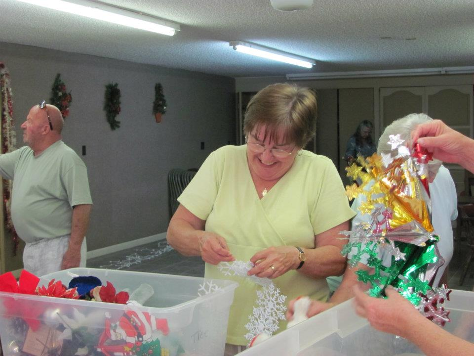 woman setting decorations for table