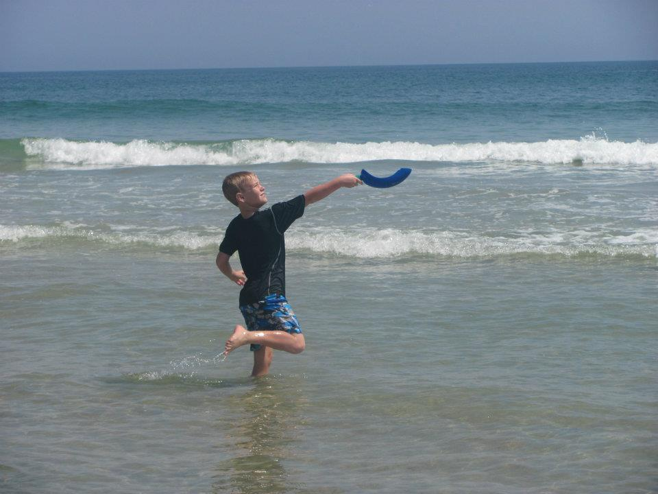 young boy catching frisbee