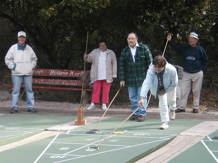 group of people playing shuffleboard