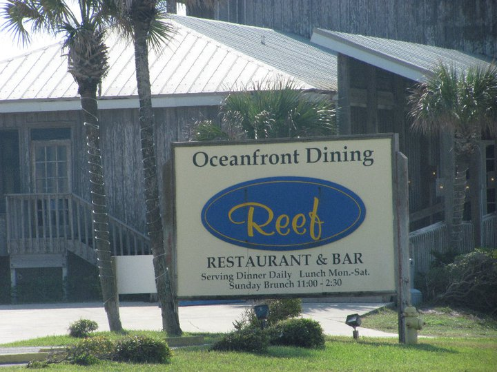 the reef restaurant sign